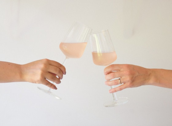 Hands toasting glasses of rosé