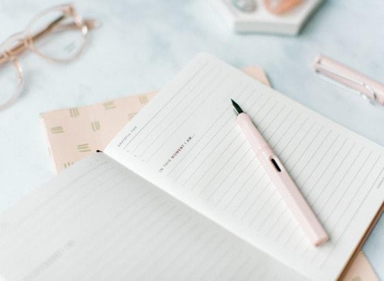 coffee journal diary pen on desk journaling writing work glasses gratitude