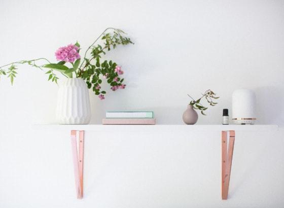 shelf plant candle aromatherapy notebooks vase