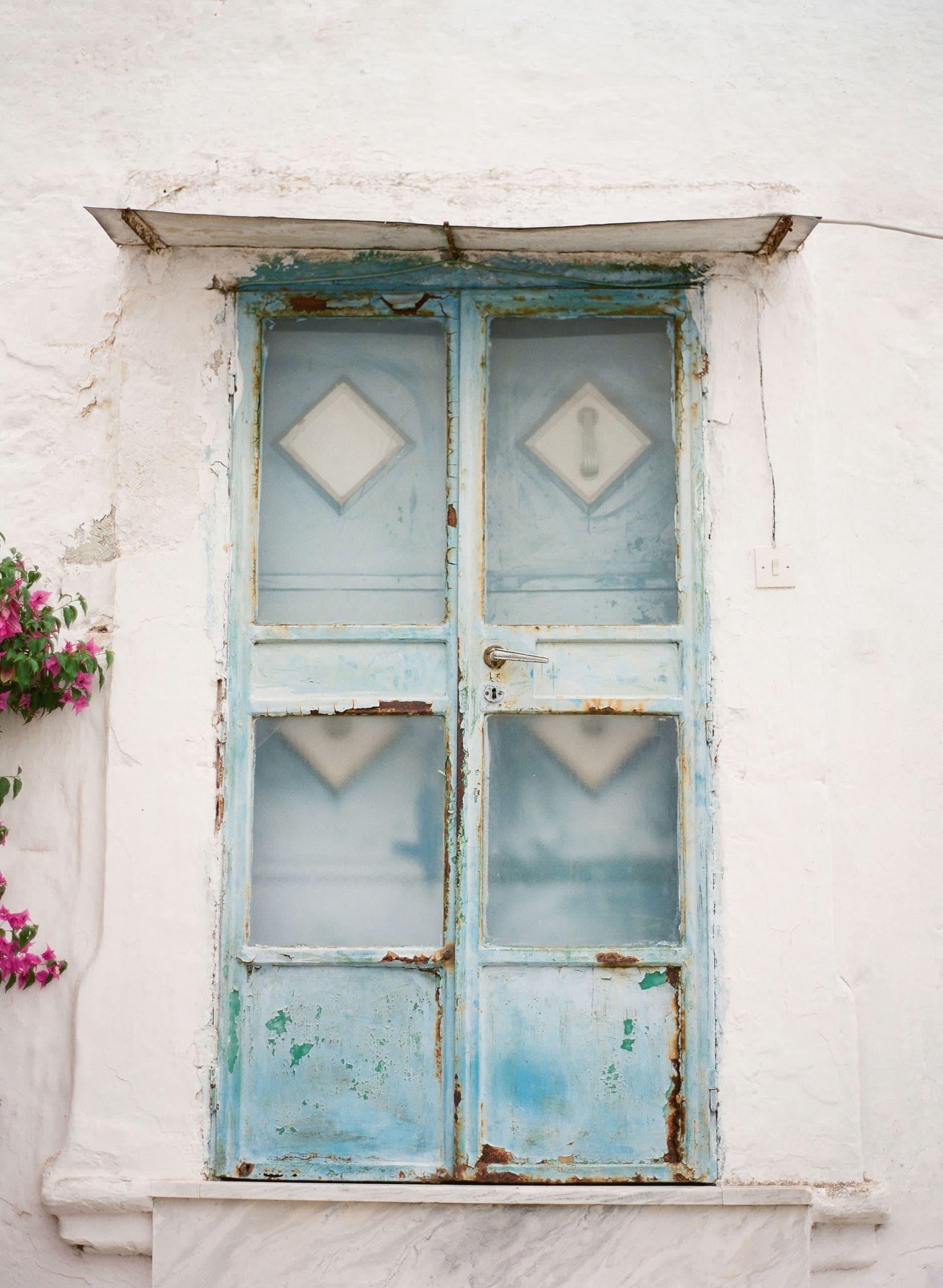 puglia italy trulli architecture buildings white travel holiday culture italian ostuni door plants flowers doorway