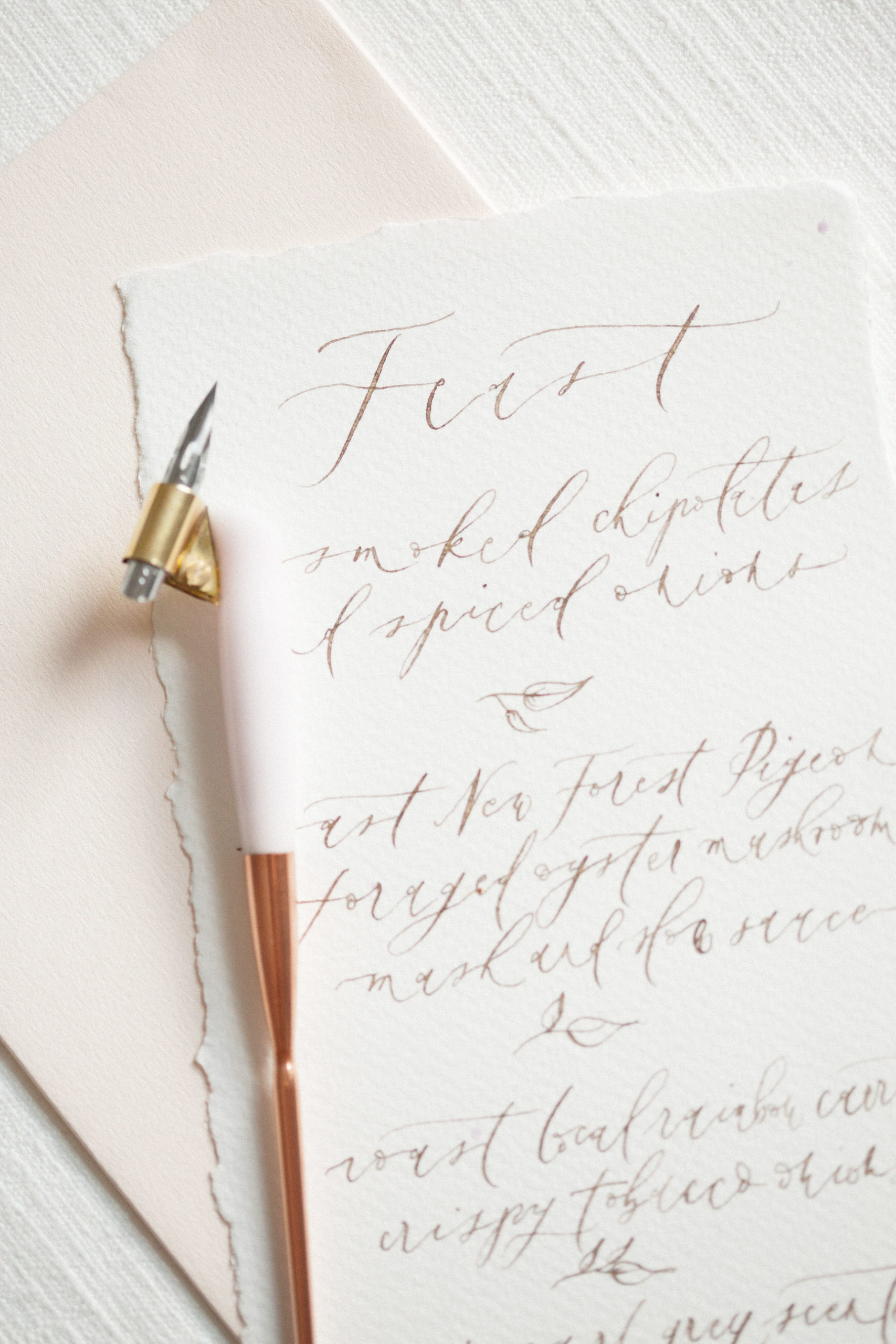 calligraphy pen flat lay styled stock photography