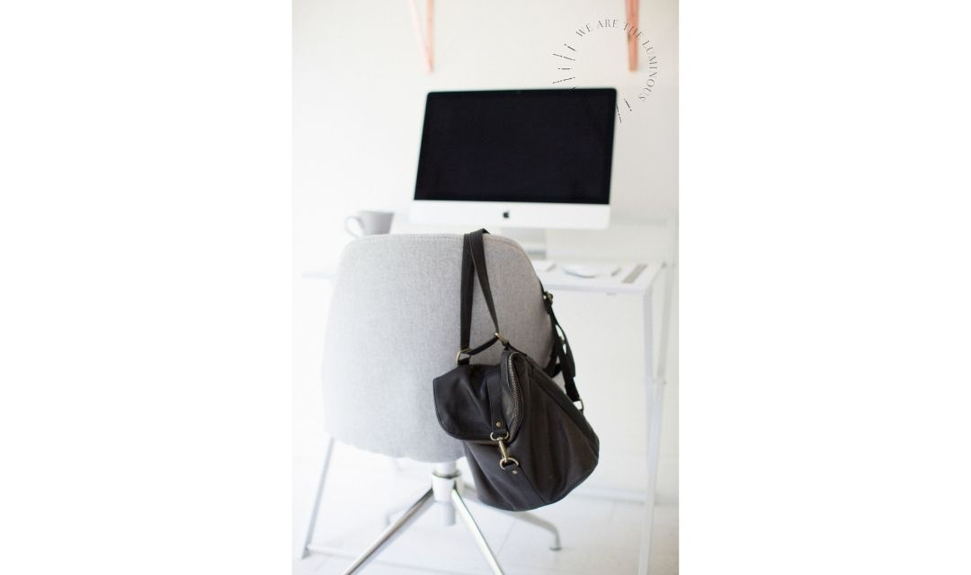 black bag hanging on office chair