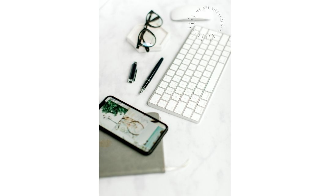 phone and glasses with computer keyboard