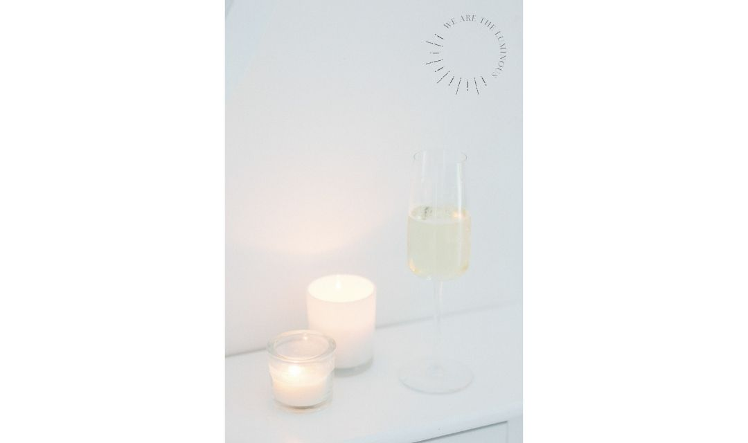 scented candles and glass of champagne