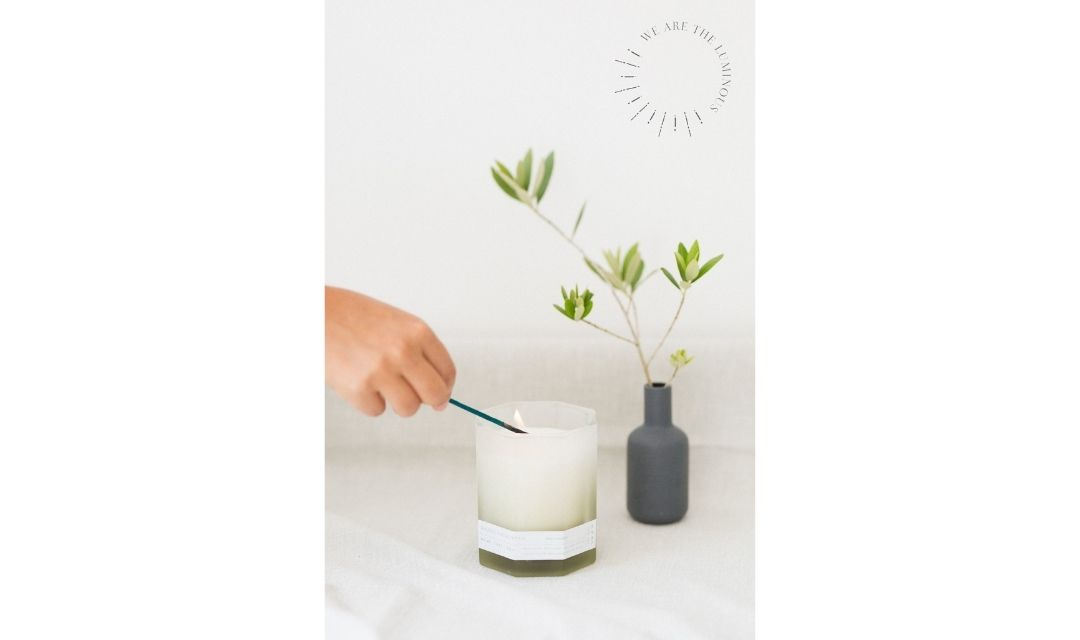 hand lighting scented candle