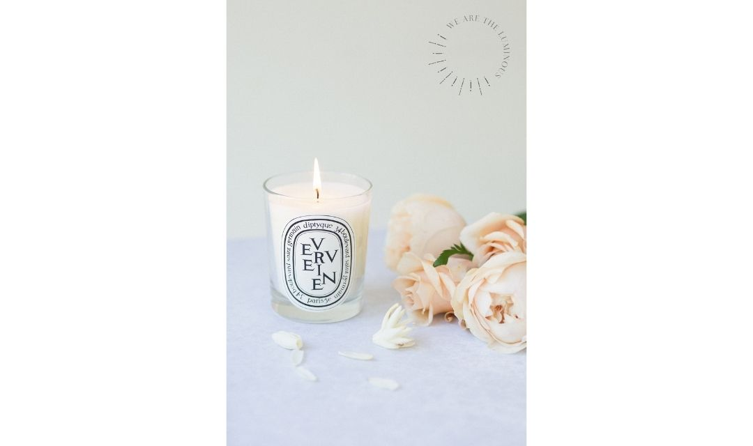 scented candle with bunch of roses