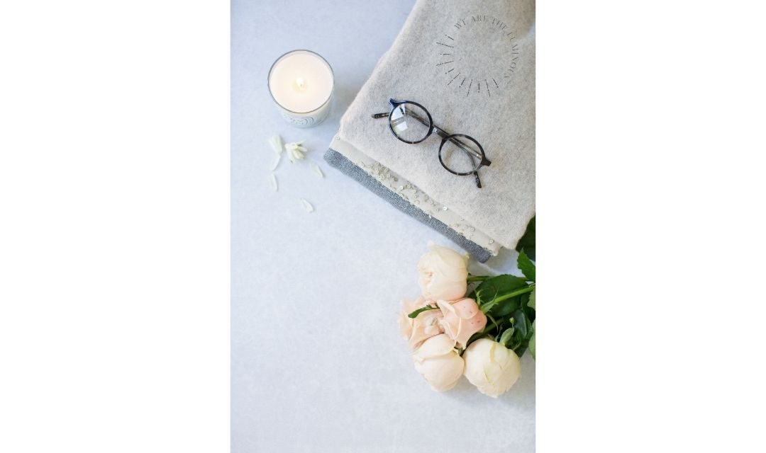 glasses and a bunch of roses