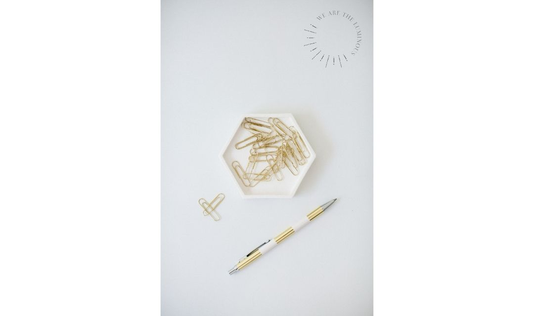 gold paperclips with pen