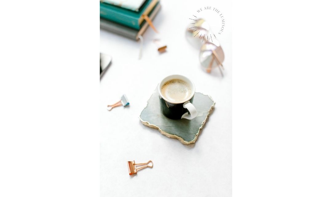 black coffee with pink stationery