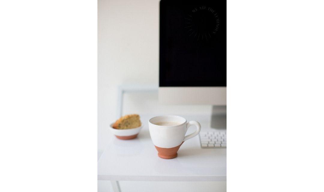 mug of coffee on office desk stock photo