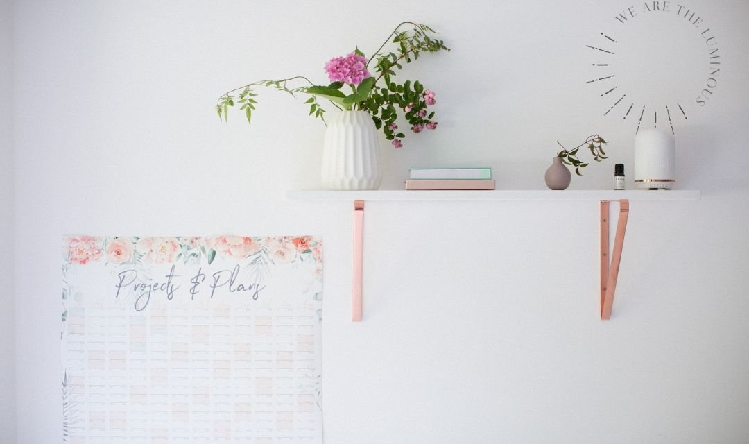 flowers in vase and wall planner