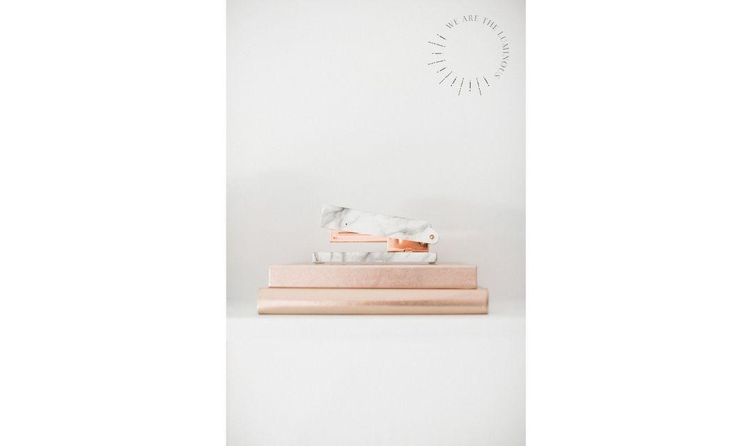 rose gold notebooks and stapler