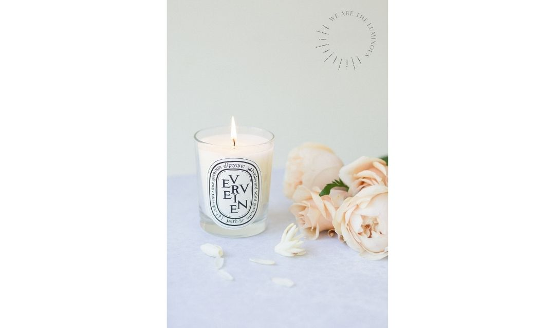 scented candle and roses stock photo