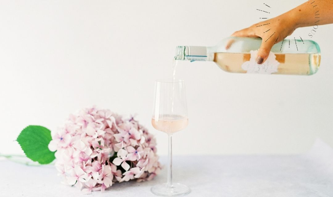 glass of rose being poured