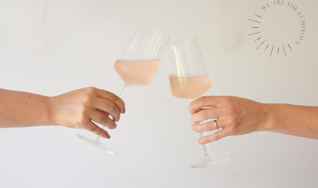 rose glasses toasting stock image