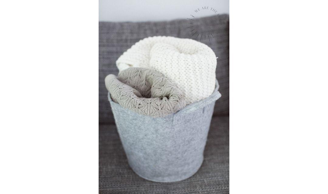 blankets in basket stock photo