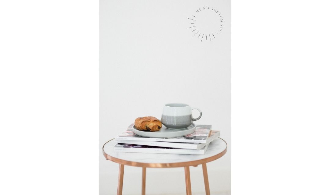 coffee cup on magazines