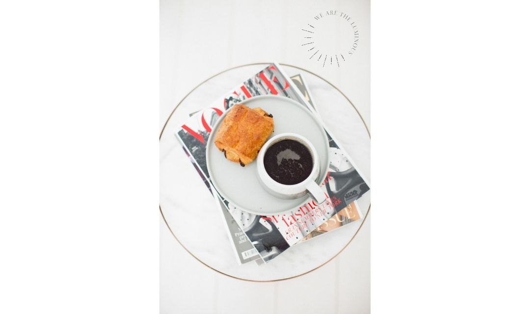 coffee and croissant on a magazine