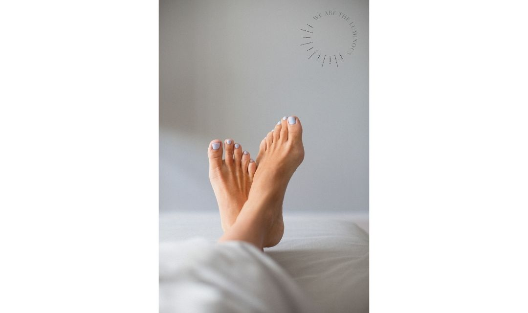 feet in bed stock photo