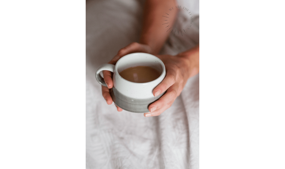 hands holding a cup of tea stock photography