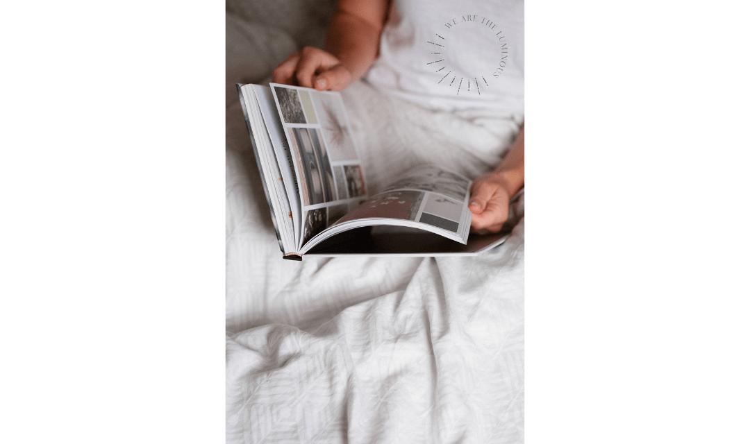 hands holding magazine stock image