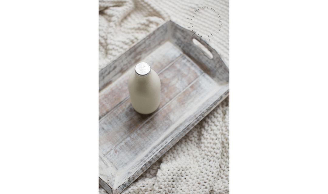 white milk bottle on tray stock image