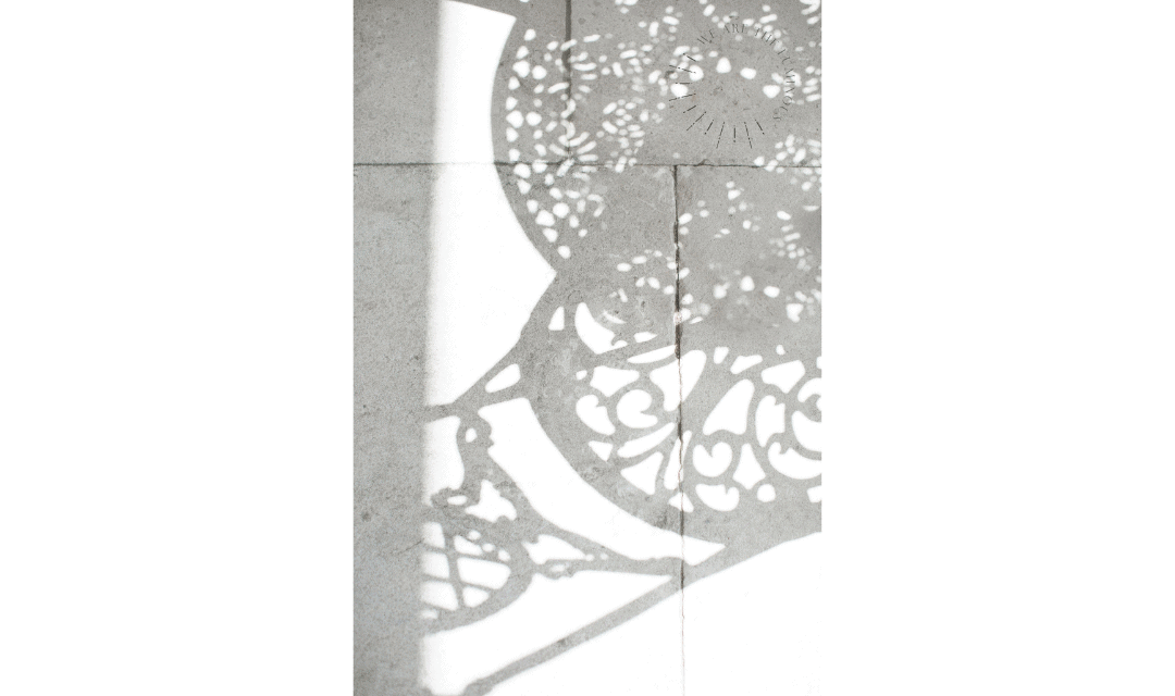 decorative shadow of chair on stone stock image