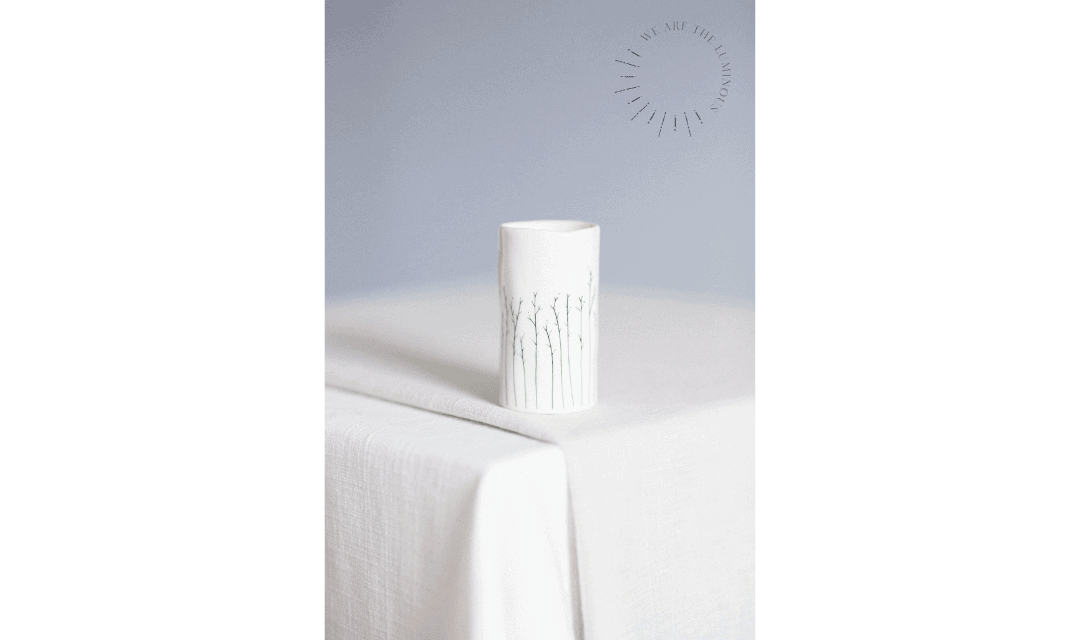 small vase on table stock image