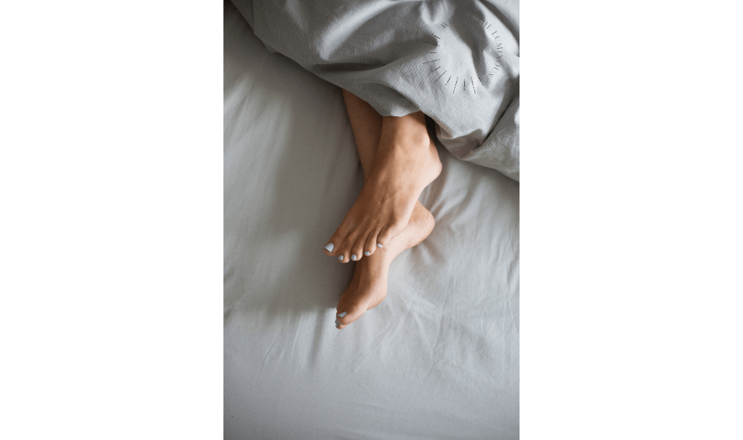 feet in bed free stock photo