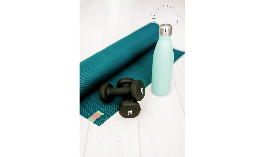 weights and yoga mat stock