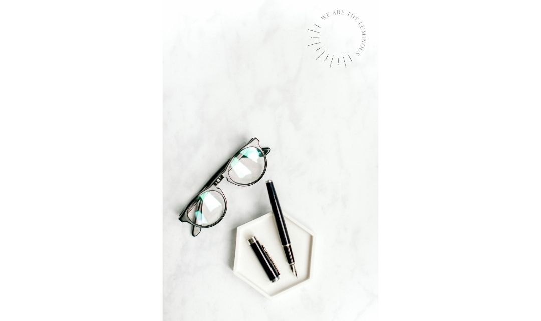 glasses and pen flat lay