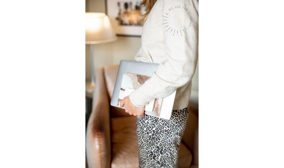 woman holding laptop stock photo