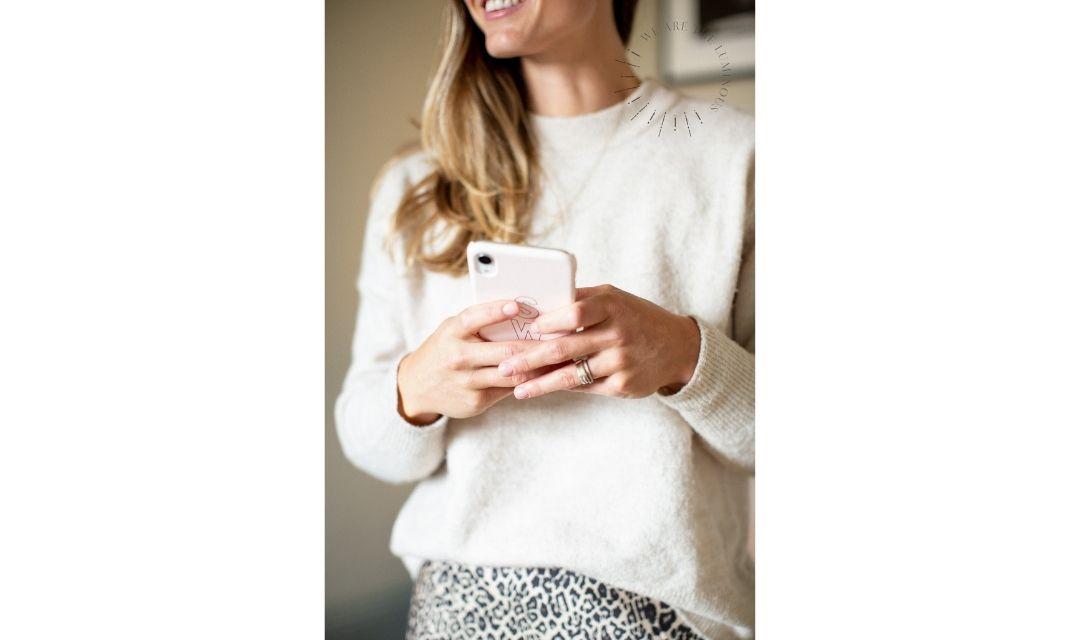 woman holding phone stock photo
