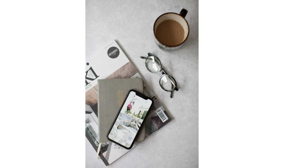 glasses and phone flat lay