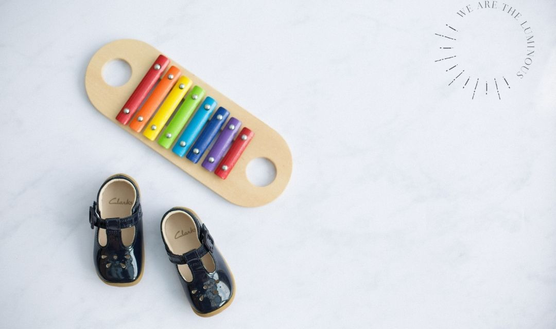 child's shoes with rainbow glockenspiel
