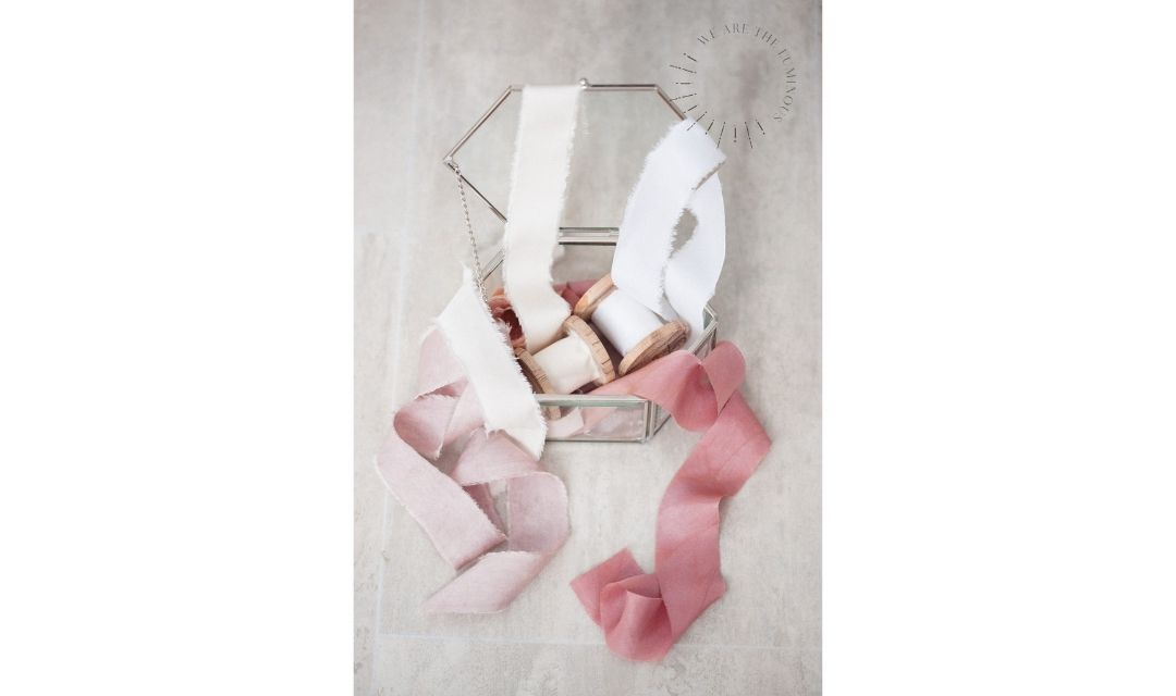 silk ribbons in glass box