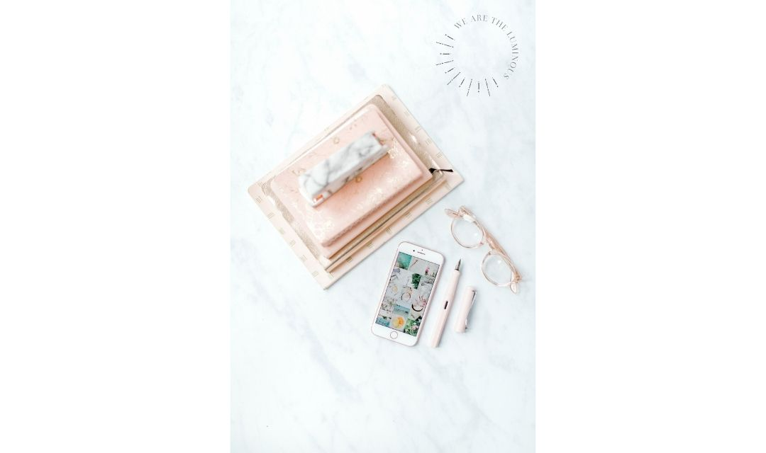 phone and pink notebooks office flat lay
