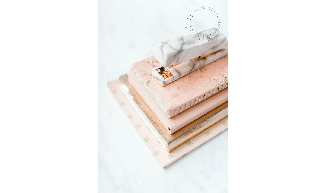 peach notebook with stapler