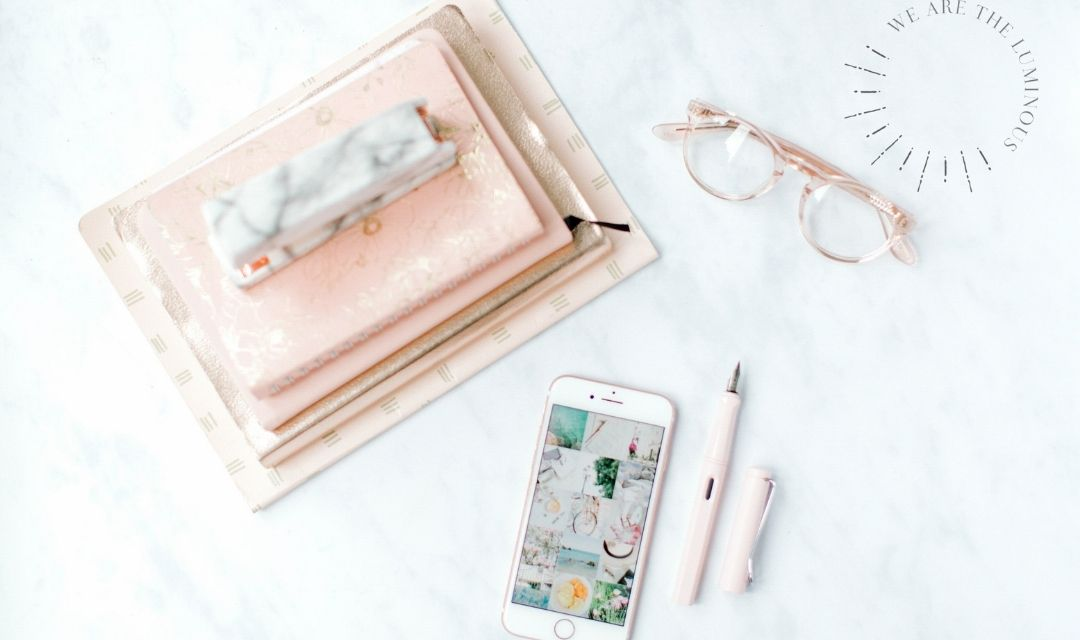 phone and pink notebooks office flatlay