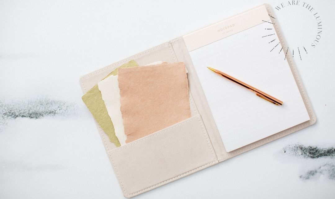 pastel notebook and papers