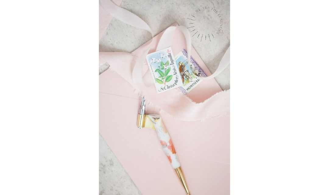 calligraphy pen with pink envelope