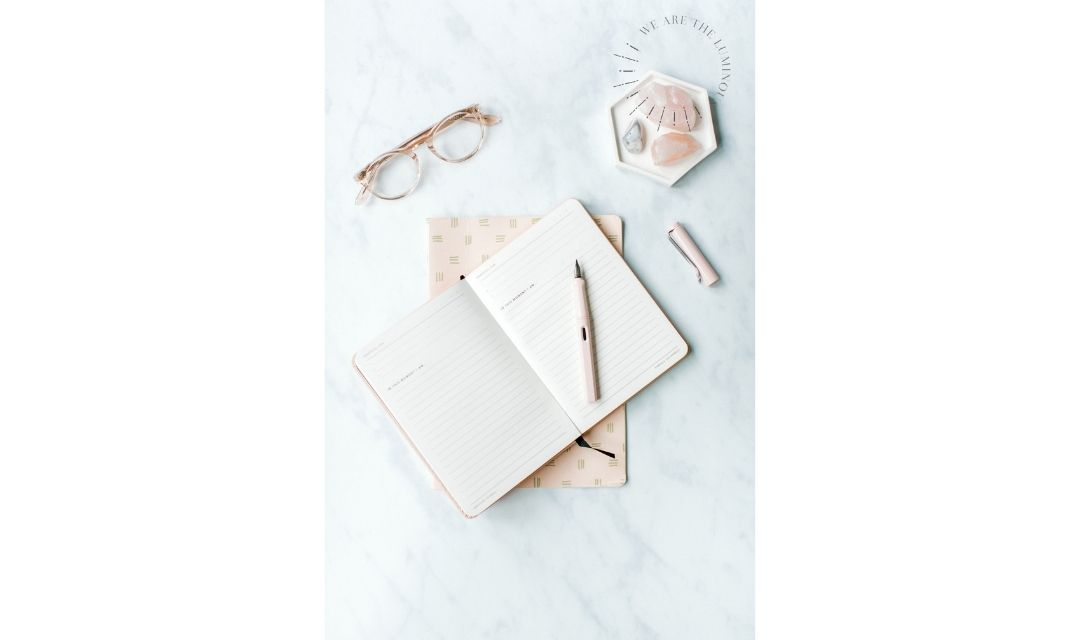 peach notebook with crystals and glasses