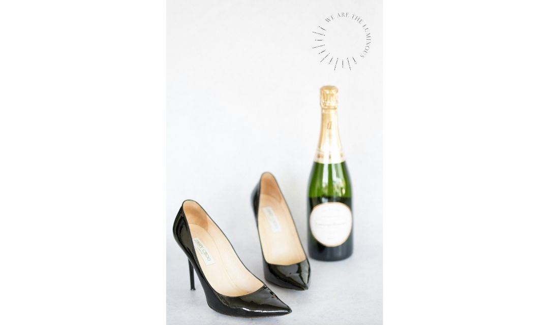 black Jimmy Choos with champagne