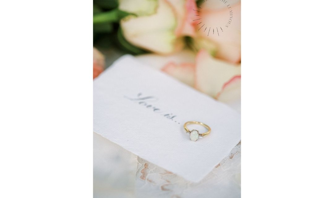 opal engagement ring with love quote and roses