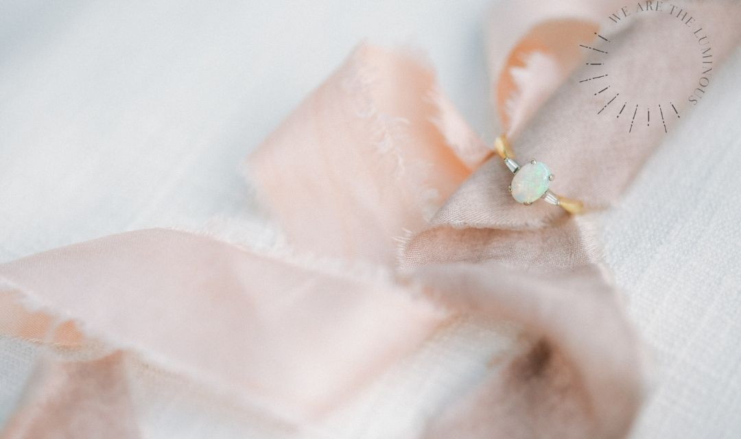 opal engagement ring with ribbons