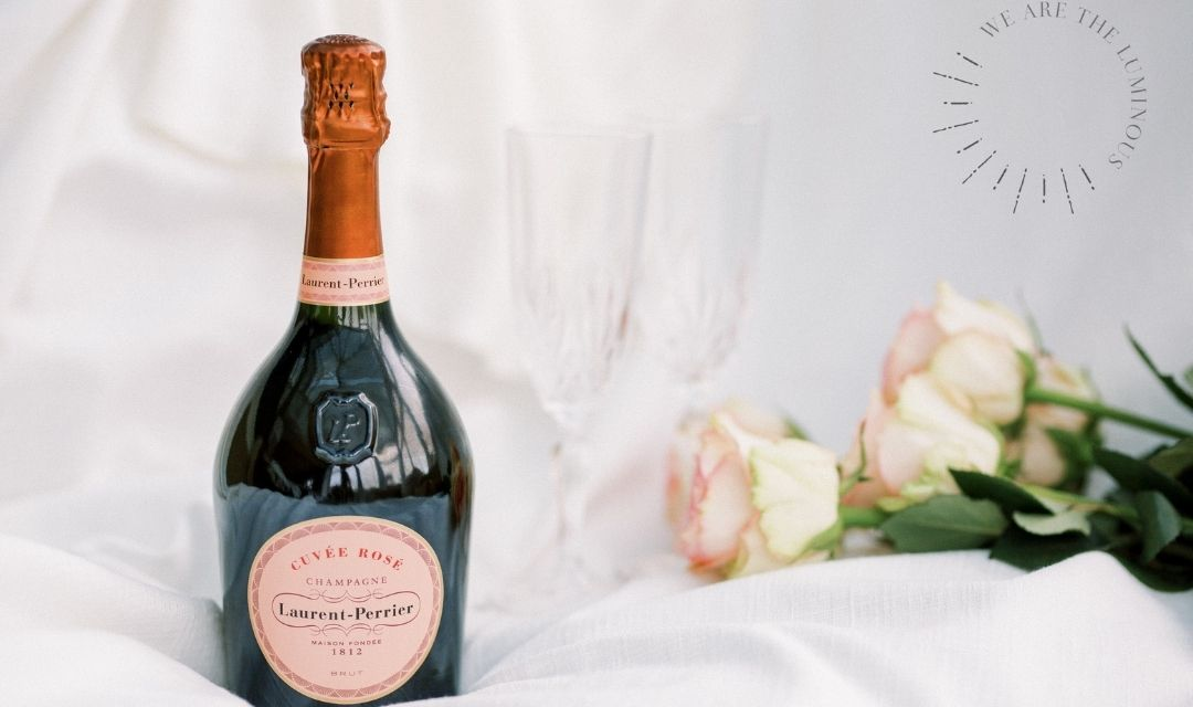 bottle of pink champagne with roses