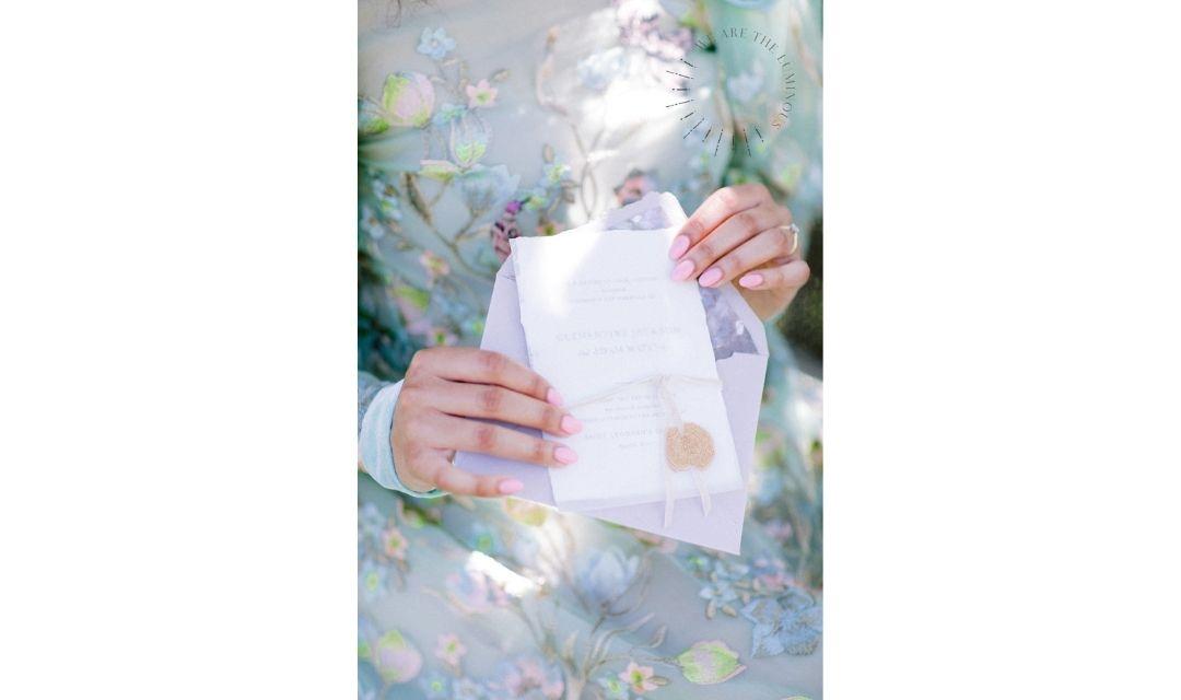 bride holding wedding stationery