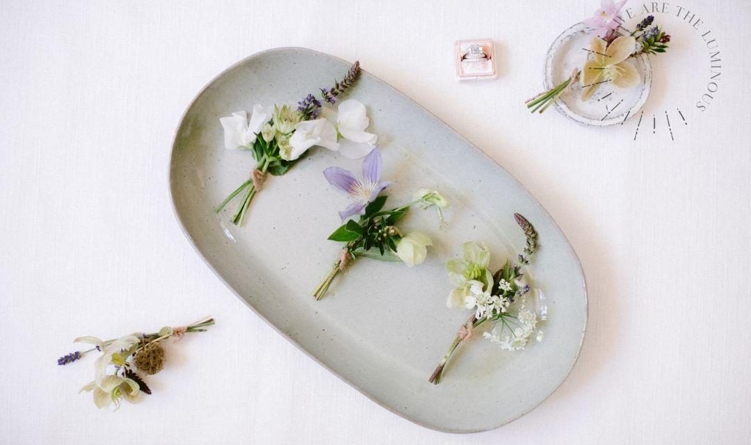 delicate wedding buttonholes